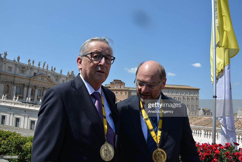 EU Parliament's speaker Martin Schulz (R) and EU Commission president Jean-Claude Juncker (L) hold a press conference on the Charlemagne Prize 2016, in Vatican City on May 06, 2016. Pope Francois has been awarded the 2016 International Charlemagne Prize.
