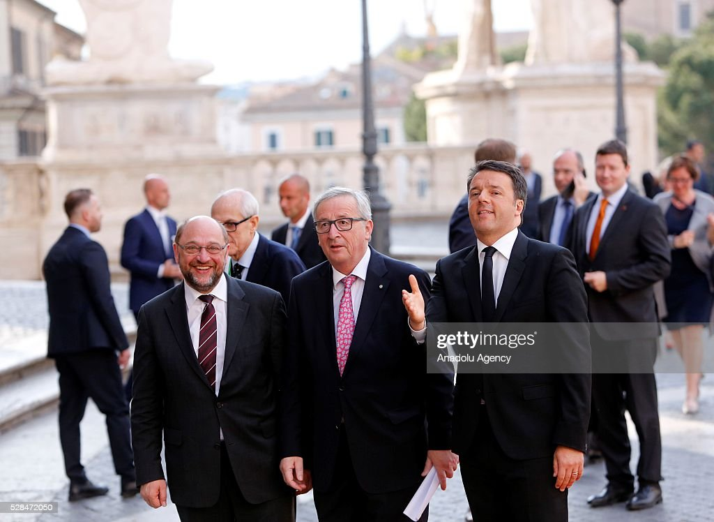 EU Parliament's speaker Martin Schulz, EU Commission president Jean-Claude Juncker and Italian Prime Minister Matteo Renzi greet media as they arrive in Piazza del Campidoglio to attend a conference on the state of the European Union at the Capitoline Museum in Rome, May 5, 2016.
