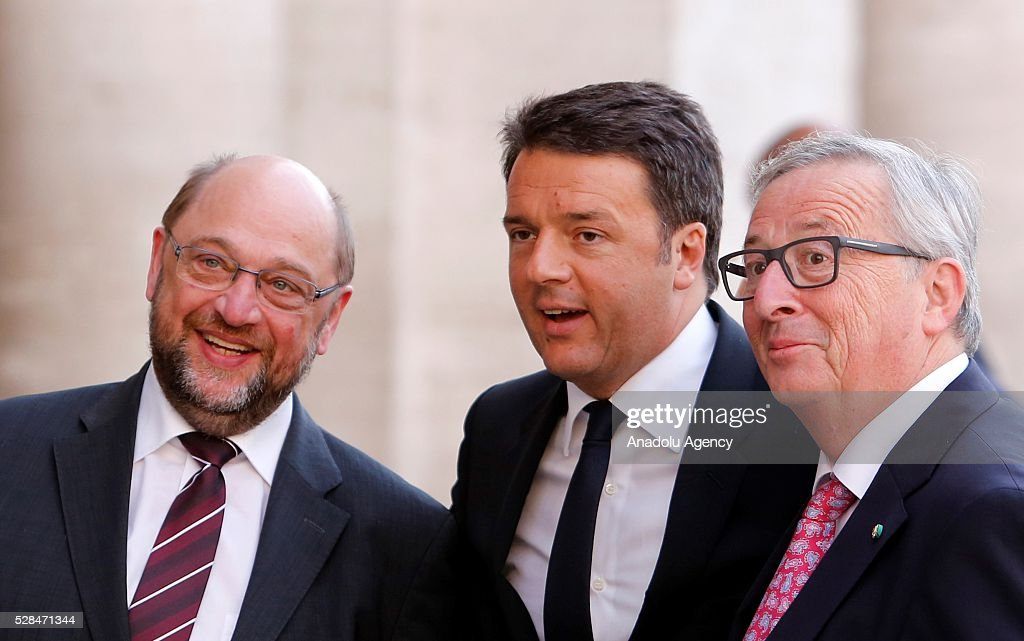 EU Parliament's speaker Martin Schulz, Italian Prime Minister Matteo Renzi and EU Commission president Jean-Claude Juncker greet media as they arrive in Piazza del Campidoglio to attend a conference on the state of the European Union at the Capitoline Museum in Rome, May 5, 2016.
