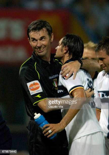 PISANU AND REFEREE FARINA during the Serie A playoff first leg match between Parma vs Bologna played at the 'Ennio Tardini' stadium in Parma