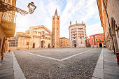 Parma cathedral with Baptistery leaning tower on the central square in Parma town in Italy