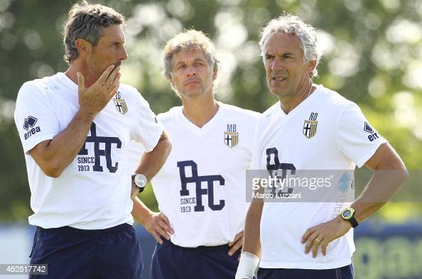 Parma FC coach Roberto Donadoni and Parma FC second coach Luca Gotti look on during FC Parma Training Session at the club's training ground on July...