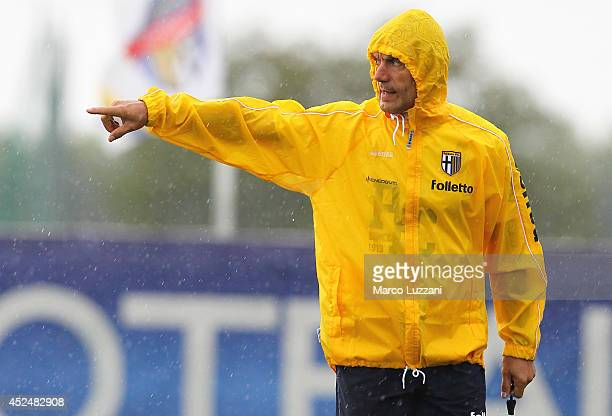 Parma FC coach Roberto Donadoni issues instructions to his players during FC Parma Training Session at the club's training ground on July 21 2014 in...