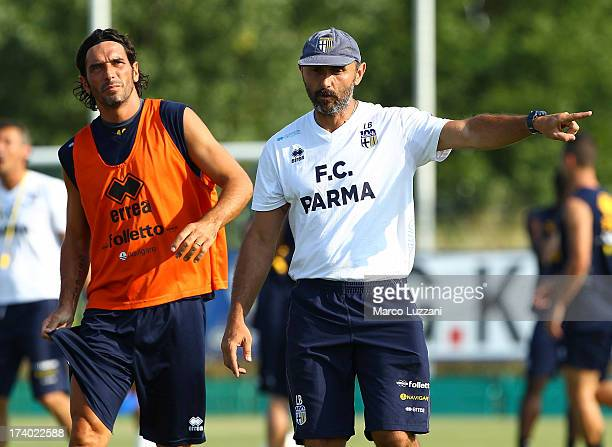 Parma FC goalkeepers coach Luca Bucci gestures during an FC Parma training session at the club's training ground on July 19 2013 in Collecchio Italy