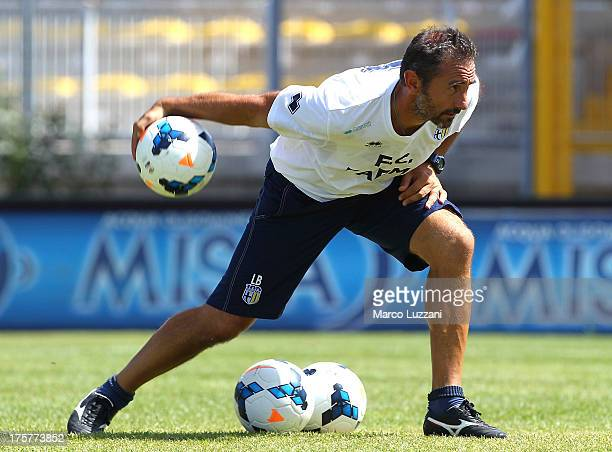 Parma FC goalkeepers coach Luca Bucci throws the ball during Parma FC Training Session at Stadio Barbetti on August 8 2013 in Gubbio Italy