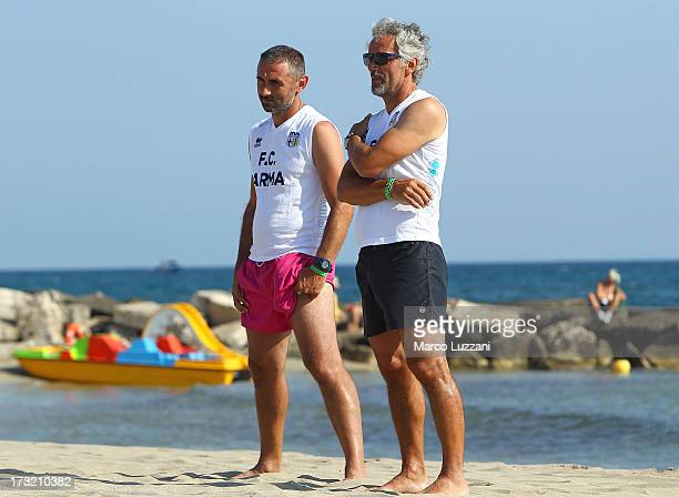 Parma FC manager Roberto Donadoni and Luca Bucci look on during Parma FC PreSeason Training Session at Rosa Marina Resort on July 10 2013 in Ostuni...