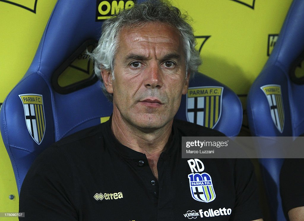 Parma FC manager <a gi-track='captionPersonalityLinkClicked' href=/galleries/search?phrase=Roberto+Donadoni&family=editorial&specificpeople=654860 ng-click='$event.stopPropagation()'>Roberto Donadoni</a> looks on before the pre-season friendly match between Parma FC and Olympique de Marseille at Stadio Ennio Tardini on July 31, 2013 in Parma, Italy.