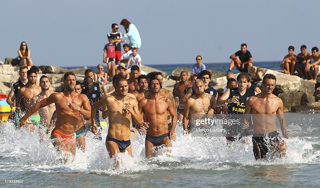 Parma FC players run in the sea during a Parma FC Pre-Season Training Session at Rosa Marina Resort on July 12, 2013 in Ostuni, Italy.
