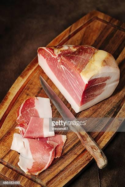 Parma ham on wooden board