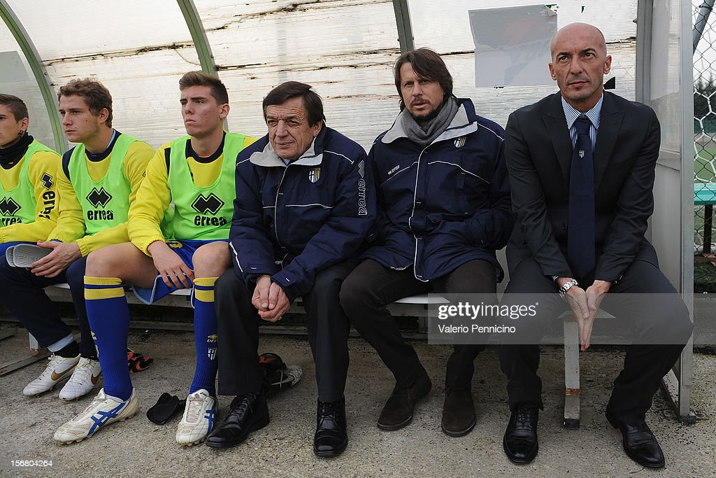 FC Parma head coach Pizzi (R) sits on the bench prior to the Juvenile match between Juventus FC and FC Parma at Juventus Center Vinovo on November 21, 2012 in Vinovo, Italy.
