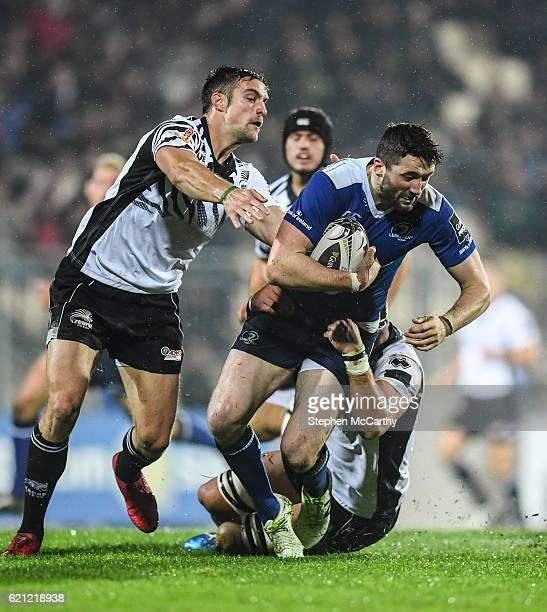 Parma Italy 5 November 2016 Barry Daly of Leinster is tackled by Andries Van Schalkwyk right and Edoardo Padovani of Zebre during the Guinness PRO12...