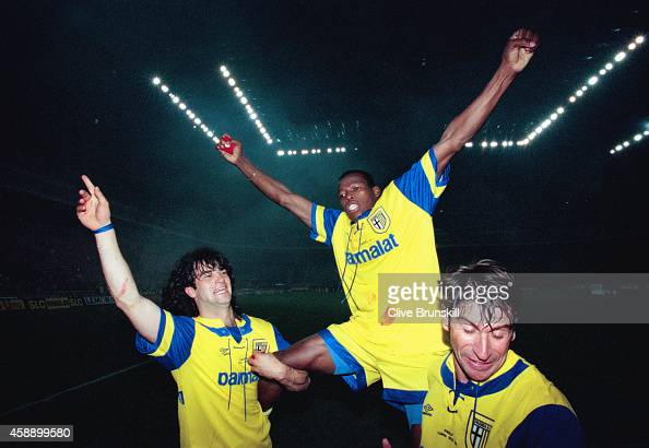 Parma striker Faustino Asprilla is held aloft by team mates Fernando Coulo and Massimo Crippa after the second leg of the 1995 UEFA Cup Final between...