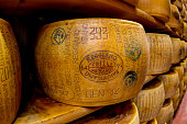 Parmigiano-Reggiano or Parmesan cheese, is a hard, granular cheese made in Italy.