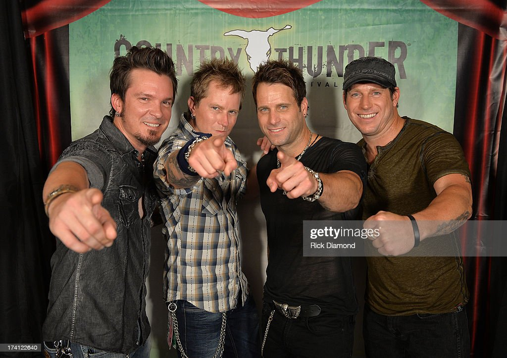 Parmalee poses backstage at Country Thunder - Twin Lakes, Wisconsin - Day 2 on July 19, 2013 in Twin Lakes, Wisconsin.