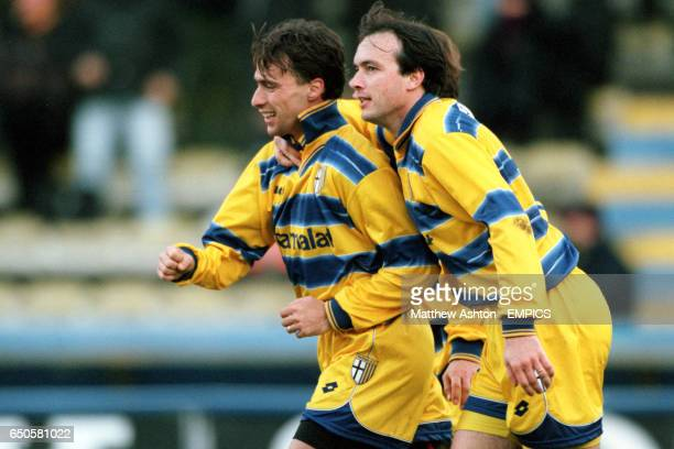Parma's Abel Balbo congratulates teammate Enrico Chiesa on scoring the third goal