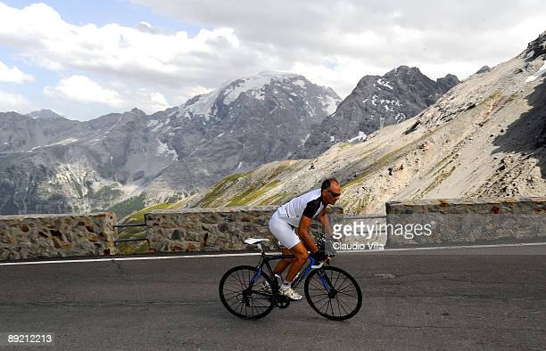 Parma's Coach Francesco Guidolin rides a bicycle during a day off at the 'Passo dello Stelvio' on July 23 2009 in Bolzano Italy