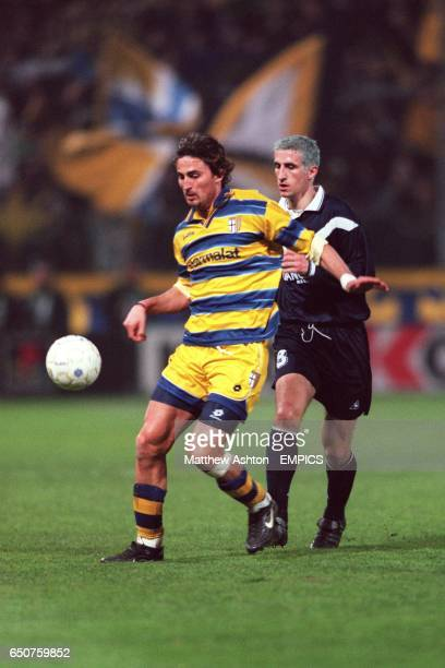 Parma's Dino Baggio shields the ball from Bordeaux's Johan Micoud