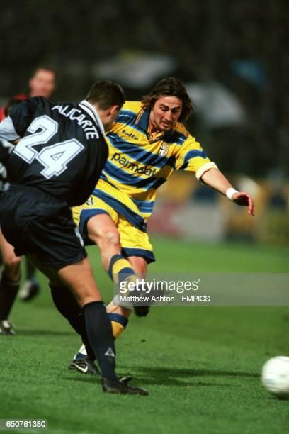 Parma's Dino Baggio slams a shot at goal