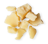 Parmesan cheese pieces isolated on white background. Closeup of italian classic cuisine condiment