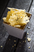 homemade parmesan chips on wood background