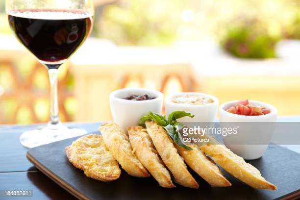 Parmesan crusted bread with a glass of red wine