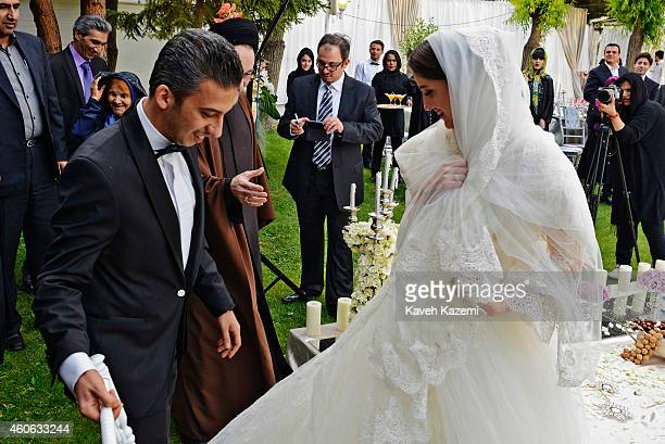 Parmis Taheri and Mostafa Aghaei after their wedding sermons at the social club of Mining Industry Bank on May 1 2014 in Tehran Iran Parmis is the...