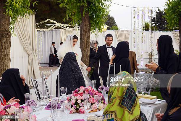 Parmis Taheri and Mostafa Aghaei during their wedding ceremony at the social club of Mining Industry Bank on May 1 2014 in Tehran Iran Parmis is the...