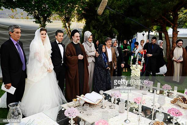 Parmis Taheri and Mostafa Aghaei make a souvenir photo with president Khatami and their parents after their wedding sermons at the social club of...