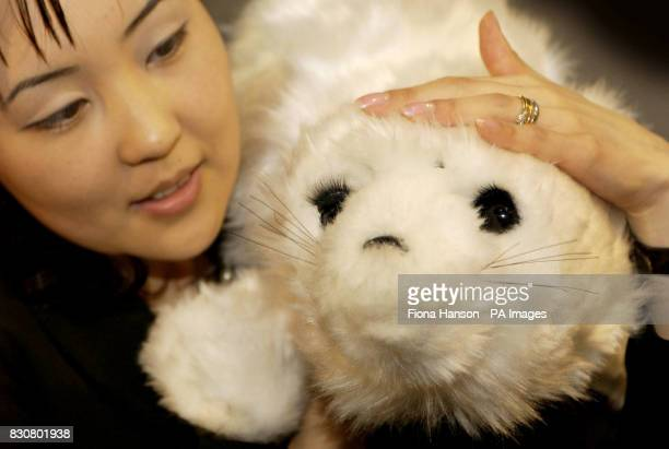 Paro a robotic seal is demonstrated at the Japan Gateway To The Future exhibition which opens at the Science Museum in London Many of the gadgets on...