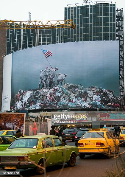 Parody of raising the flag on iwo jima historic picture on Valiasr Square showing american marines on dead bodies in the Central District on December...
