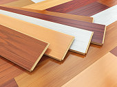 Parquet o laminate wooden planks of the different colors on the floor. 3d illustration