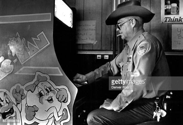 Parrott Don Ind Parrott likes to spend the afternoon in his wife's bar the Artesia playing his favorite game Ms PacMan Credit The Denver Post
