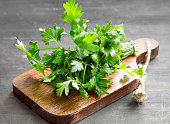 Parsley Culinary Herb on a Wooden Cutting Board