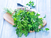 parsley on wooden board and on a table