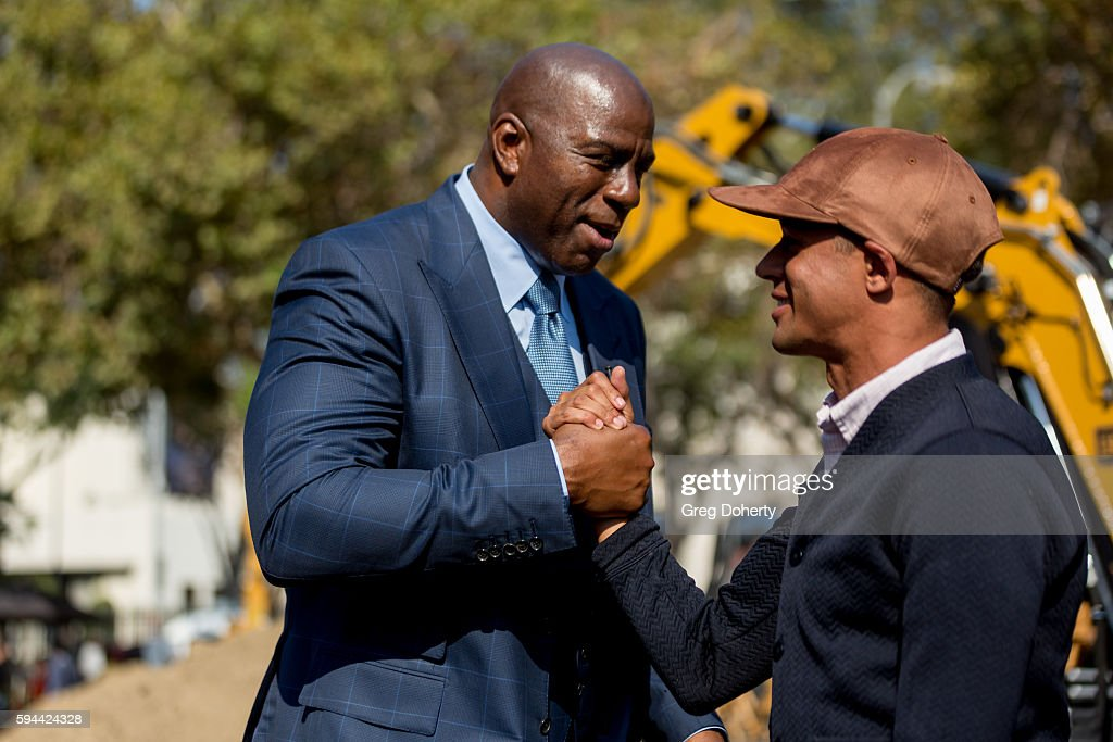 Part LAFC owner Earvin 'Magic' Johnson chats with former professional soccer player Calen Carr at the Los Angeles Football Club Stadium...