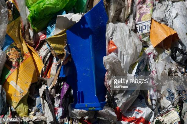 Part of a blue city issued recyclables container is seen amongst sortedout containment piled up outside the Materials Recovery Facility in South...