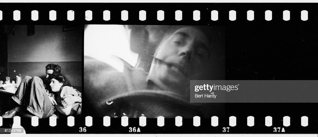 Part of a contact sheet depicting a couple in a basement in the Elephant and Castle, South London along with a self-portrait of photographer Bert Hardy as he winds on the last frame of his film, 8th January 1949. Original publication: Picture Post - 4694 - Life In The Elephant - pub. 1949