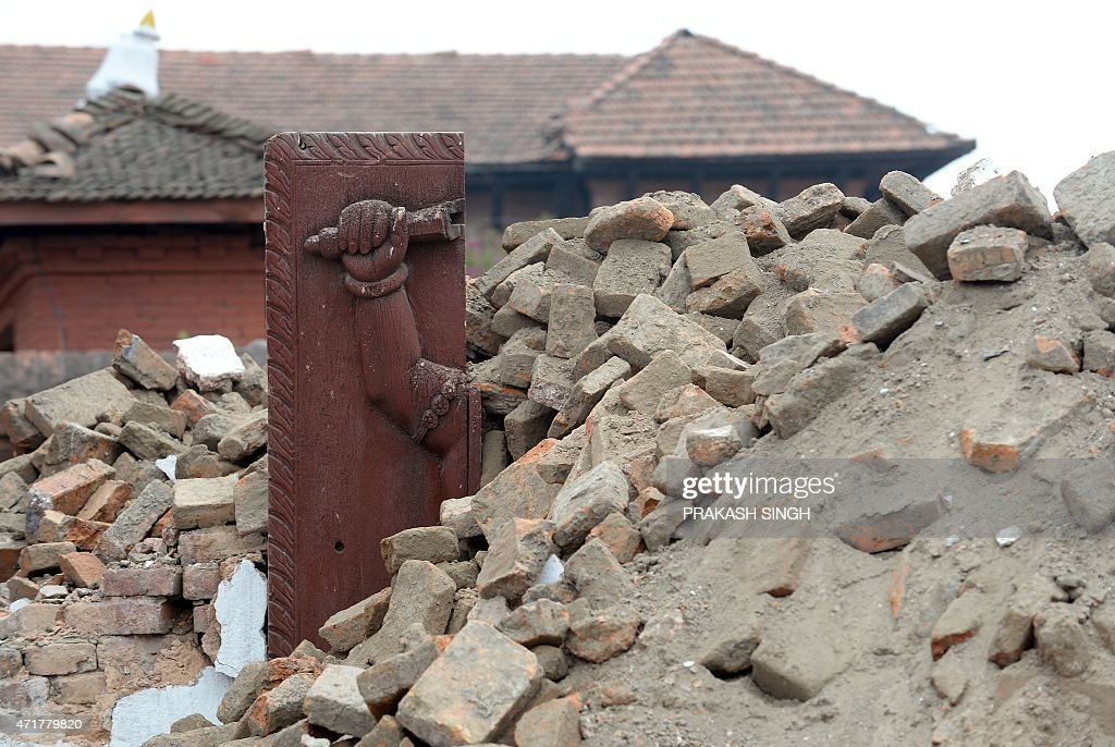 A part of a damaged gate of Durbar Square stands out of debris in Bhaktapur on the outskirts of Kathmandu on May 1 following a 78 magnitude...