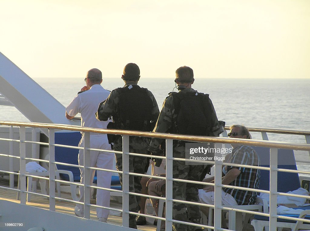 CONTENT] Part of a French Navy contingent deployed on board the luxury cruise ship the Seabourn Spirit while in transit in a safety convoy through the Gulf of Aden. The Gulf adjoins Somalia.