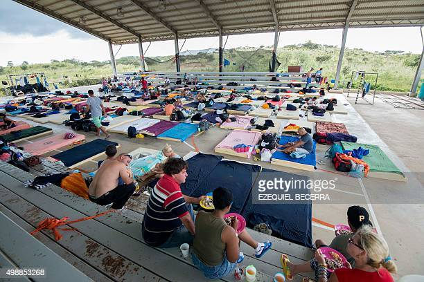 Part of a group of 300 Cuban migrantstobe rest in a shelter in La Cruz Guanacaste Costa Rica near the border with Nicaragua on November 26 2015 Latin...