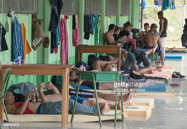 Part of a group of 300 Cubans who remain in a shelter rest in La Cruz Guanacaste Costa Rica near the border with Nicaragua on November 26 2015 Latin...
