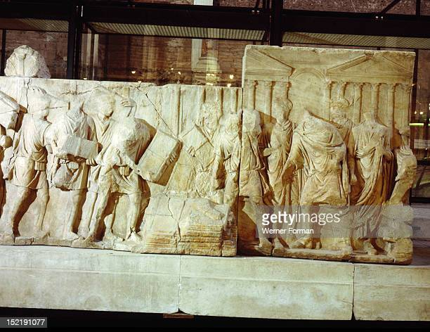 Part of a marble relief apparently showing various measures taken by Trajan It dates from the reign of Hadrian and was found at the Forum Italy Roman