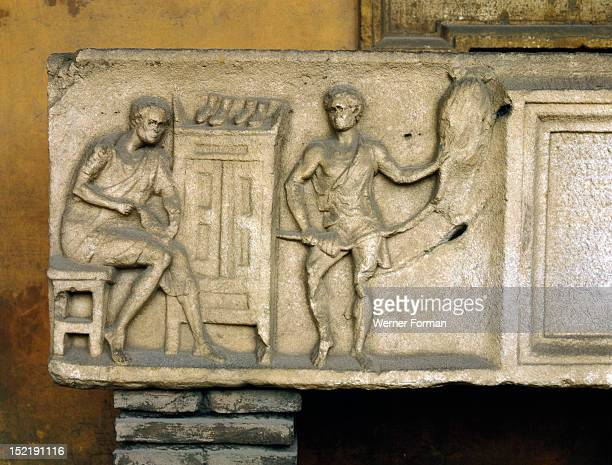 Part of a sarcophagus with a relief showing a shoemaker at work A Greek inscription names the man his wife a friend The prosperity brought to Ostia...