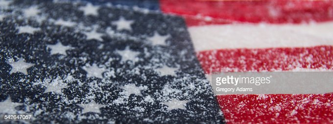 Part of a snow covered American flag