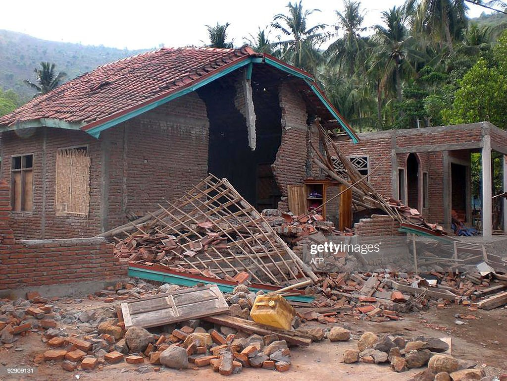 Part of a wall lays in ruins in the town of Bima following a strong 6.7 magnitude earthquake that rocked the Indonesian island of Sumbawa on November 9, 2009. The Indonesian state news agency said two people were killed and dozens injured after the quake stuck in the early hours from the town of Raba at a depth of 18 kilometres.