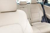 Part of bright leather car seat. Luxury car interior.