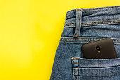 Cellphone in blue jeans back pocket.
