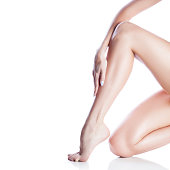 Girl leg. Smooth skin, hand with manicure nails. Copy space. Isolated. White background