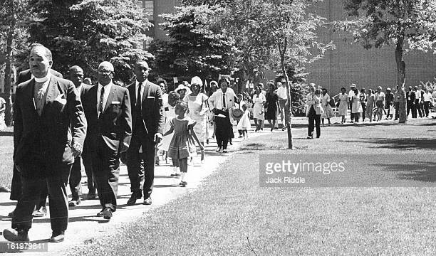 JUN 22 1963 JUN 24 1963 Part of Group of 150 Marchers moves through Denver Sunday in 10Block Procession Carrying black flags and wearing black...
