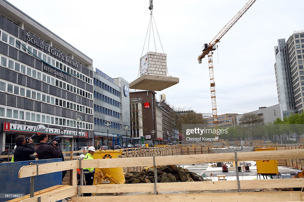 A part of masonry hangs on a crane at the construction area during the DFB Football Museum groundbreaking ceremony at Koenigswall on April 29, 2013 in Dortmund, Germany.